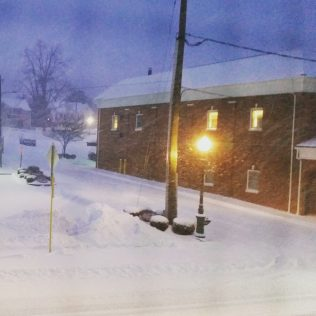 Friday, 1/22: Snow in the lamplight at twilight. So pretty and peaceful!
